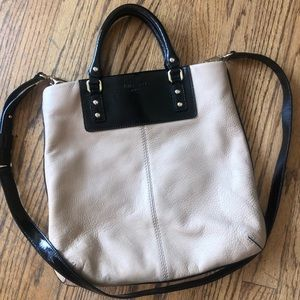 Tan and black Kate Spade bag with gold hardware
